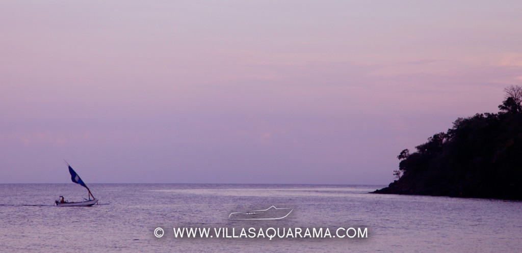 balinese boat with beautiful sunset in amed